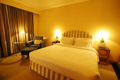 Luxury Hotel Room. A warm and cosy bedroom during vacation royalty free stock photo