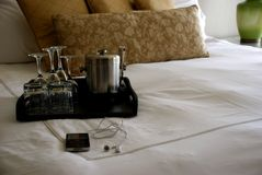 Luxury Hotel Room Bed with Drinks Tray and iPod Royalty Free Stock Image