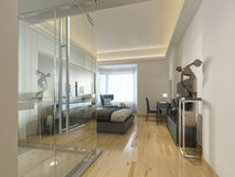 A luxury hotel room in a contemporary design with glass bathroom Stock Photography