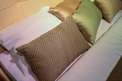 Luxury hotel room setting with bed and pillows. Royalty Free Stock Photo
