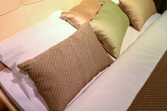 Luxury hotel room setting with bed and pillows. Stock Photo