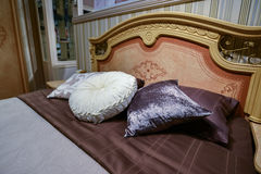Luxury hotel room setting with bed and pillows. Stock Photography