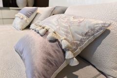 Luxury hotel room setting with bed and pillows. Royalty Free Stock Image