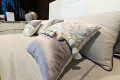 Luxury hotel room setting with bed and pillows. Stock Photos