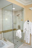 Luxury Hotel Shower and Robe. A nice shower and robe in a luxury hotel bathroom Stock Photography
