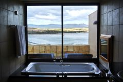 Luxury hotel suite bathroom palace View of Botrivier Lagoon over stock images