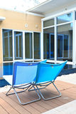 Luxury hotel swimming pool. Relax chairs luxury hotel swimming pool Stock Photography
