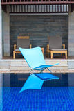 Luxury hotel swimming pool. Relax chairs luxury hotel swimming pool Stock Image