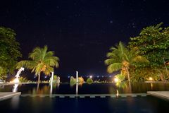 Hotel with a pool in the background of the starry sky. Stock Image