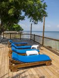Luxury Hotel Tropical Beach Resort. Tanning deck and chairs at a luxury tropical beach resort. People love to go to the ocean to relax while on vacation or Stock Photography