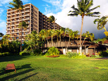 Luxury hotel in tropical setting. A luxury hotel in tropical setting, more precisely on Kaanapali beach in Maui Hawaii. Tropical garden with  green grass and Royalty Free Stock Photography