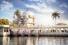 Luxury hotel in Udaipur. Luxury hotel on the Pichola lake at blue cloudy sky in Udaipur, Rajasthan, India stock photography