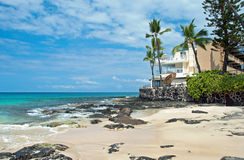 Luxury hotel on untouched sandy beach with palms trees and azure stock images