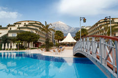 Luxury hotels exterior with pool and small bridge Royalty Free Stock Images