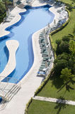 Luxury hotels with water pool. Luxury hotels with curve beautiful water pool Royalty Free Stock Photos