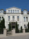 Luxury house. Beautiful Luxury house with firs and blue sky stock photography