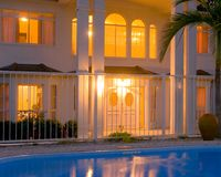 Luxury house. A magnificent home and pool at dusk in Rockhampton,Central Queensland,Australia Royalty Free Stock Photography