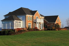 Luxury House. With sunroom and balcony at large lawn royalty free stock photography
