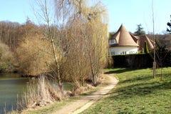 Luxury house along pond Stock Image