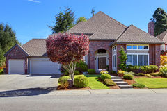 Luxury house with brick wall trim and beautiful curb appeal Stock Photography