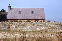 Luxury house in Brittany. Luxury granite house along the sea in the Pink granite coast in Cote d'Armor in Brittany in France Stock Photography