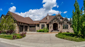 Luxury house in Calgary, Canada. Panorama of Luxury house on a sunny day in Calgary, Canada royalty free stock photography