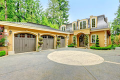 Luxury house exterior. Luxury house with beautiful curb appeal. View of three car garage and driveway Royalty Free Stock Image