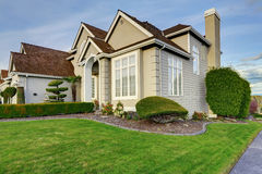 Luxury house exterior with curb appeal. Luxury house with small entrance porch, walkway and curb appeal Royalty Free Stock Image