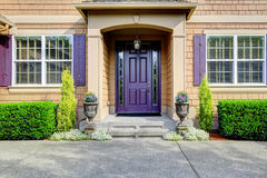 Luxury house exterior. Entrance porch with purple door Royalty Free Stock Image
