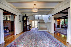 Luxury house. Hallway with rug and staircase Stock Photos