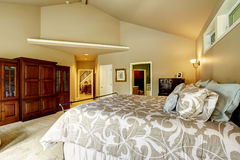 Luxury house interior. Bedroom with high vaulted ceiling a Royalty Free Stock Images