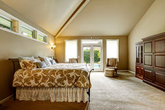 Luxury house interior. Bedroom with high vaulted ceiling and walkout deck royalty free stock photo