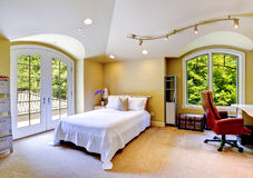 Luxury house interior. Bedroom with walkout deck Royalty Free Stock Image