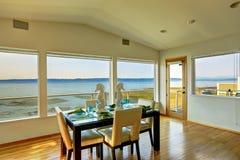 Luxury house interior. Bright elegant dining area with scenic ba Stock Photos