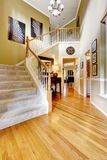 Luxury house interior. Hallway with high ceiling and staircase Royalty Free Stock Photos