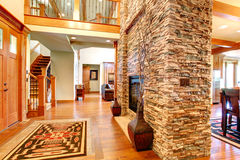 Luxury house interior. Stone wall with fireplace Royalty Free Stock Image