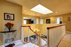 Luxury house interior. Upstairs hallway with staircase Stock Photo