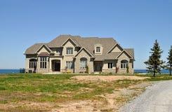 Luxury house on the lake Royalty Free Stock Image