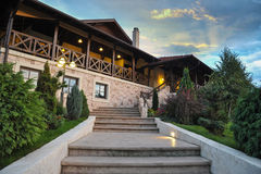 Luxury House. Made of stone and wood with stairs leading to entrance Royalty Free Stock Photos