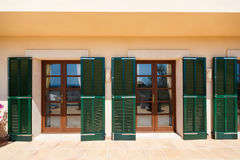 Luxury house in Mallorca. The glass doors of the Spanish home nearby the Mediterranean Sea, Mallorca Royalty Free Stock Images