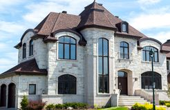 Luxury house in Montreal. Canada against blue sky stock photos