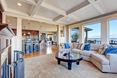 Luxury house with open floor plan. Coffered ceiling, carpet and Stock Image
