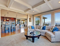 Luxury house with open floor plan. Coffered ceiling, carpet and Stock Photos