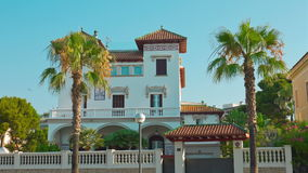 Luxury house and palm trees establishing shot, Salou in Spain. Costa Daurada in Catalonia, Spain, shot in RAW 4K stock footage