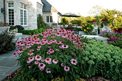 Luxury House with patio. And flowers Stock Photos