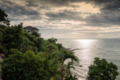 Luxury house at Pattaya beach. Luxury house at mountain near Gulf Coast Pattaya beach at sunset, Chonburi, Thailand Stock Image