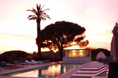 Luxury house pool at sunset Royalty Free Stock Photography