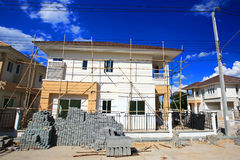 Luxury house under construction. Against blue sky Royalty Free Stock Photography