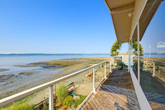 Luxury house with walkout deck and private beach. Puget Sound vi Royalty Free Stock Images