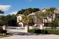 Luxury house with a white gate Stock Image